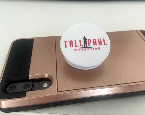 Tall Paul Marketing pop socket on smartphone - copywriter belfast